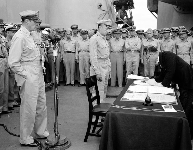 Japan's foreign minister surrenders while MacArthur watches.
