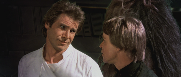 Han Solo looking skeptically and Luke Skywalker