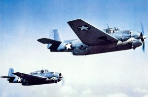 Two U.S. Navy Grumman TBF-1 Avenger torpedo bombers in flight, circa 1942